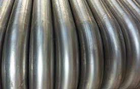 Close up view of a row of pipes with mandrel bends.