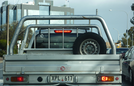 Rear view of a ute with bent tube ute bars installed.